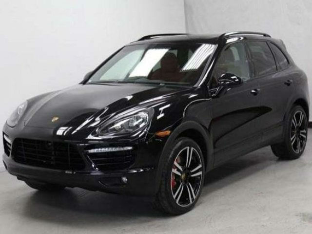 2014 porsche cayenne turbo s black for Garage porsche caen